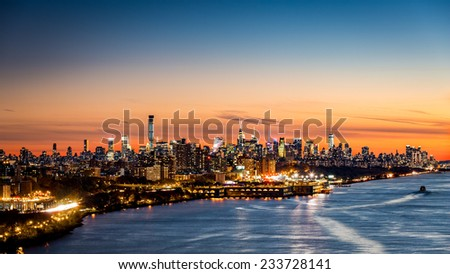 New York cityscape at sunset as viewed from George Washington Bridge - stock photo
