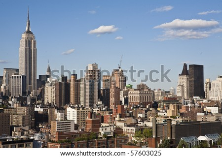 New York cityscape with apartments and office buildings. The Empire State building is visible in the background. Horizontal shot. - stock photo