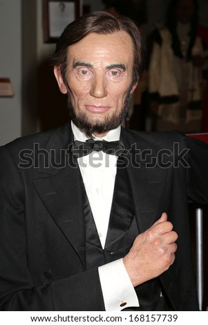 NEW YORK - Dec 6: A wax figure of Abraham Lincoln is seen on display at Madame Tussauds on December 6, 2013 in New York City. - stock photo