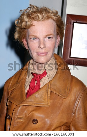 NEW YORK - Dec 6: A wax figure of Amelia Earhart is seen on display at Madame Tussauds on December 6, 2013 in New York City. - stock photo