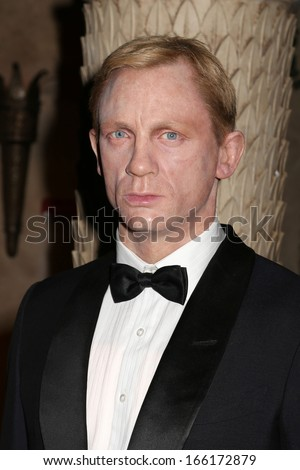 NEW YORK - Dec 6: A wax figure of Daniel Craig is seen on display at Madame Tussauds on December 6, 2013 in New York City. - stock photo