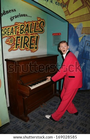 NEW YORK - Dec 6: A wax figure of Jerry Lee Lewis is seen on display at Madame Tussauds on December 6, 2013 in New York City. - stock photo