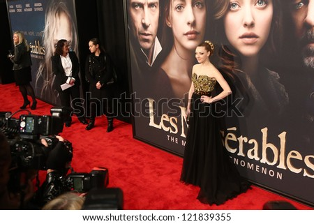 """NEW YORK-DEC 10: Actress Amanda Seyfried attends the premiere of """"Les Miserables"""" at the Ziegfeld Theatre on December 10, 2012 in New York City. - stock photo"""