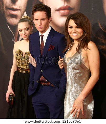 """NEW YORK- DEC 10: Amanda Seyfriend, Eddie Redmayne and Samantha Banks attend the premiere of """"Les Miserables"""" at the Ziegfeld Theatre on December 10, 2012 in New York City. - stock photo"""