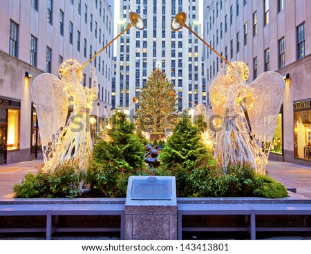 NEW YORK - DEC 28: Famous Rockefeller Center Christmas tree as seen from 5th Avenue on December 28th, 2011 in New York - stock photo