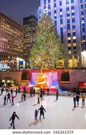 NEW YORK-DEC 5: Ice skaters and tourists are all around the famous Rockefeller Center Christmas tree on December 5, 2013. - stock photo