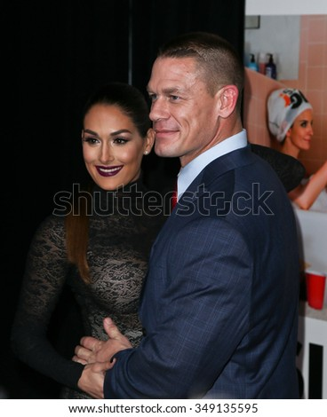 "NEW YORK-DEC 8: John Cena (R) and Nikki Bella attend the premiere of ""Sisters"" at the Ziegfeld Theatre on December 8, 2015 in New York City. - stock photo"