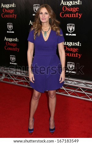 """NEW YORK - DEC 12:  Julia Roberts attends the premiere of """"August: Osage County"""" at the Ziegfeld Theater on December 12, 2013 in New York City. - stock photo"""