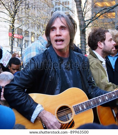 NEW YORK - DEC 1: Musician Jackson Browne performs in Zuccotti Park, Lower Manhattan, on December 1, 2011 in New York City. Browne was there to play music in support of the Occupy Wall Street protest. - stock photo