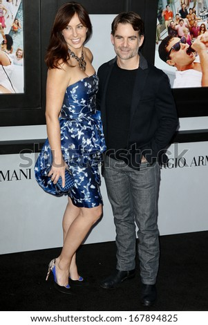 "NEW YORK-DEC 17: Racecar driver Jeff Gordon (R) and wife Ingrid Vandebosch attend ""The Wolf of Wall Street"" premiere at the Ziegfeld Theatre on December 17, 2013 in New York City. - stock photo"