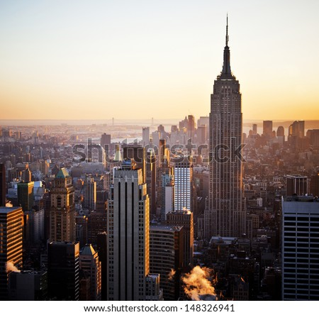 NEW YORK - DEC 29: The iconic Empire State Building and New York Skyline on December 29th, 2009 in New York City, USA - stock photo
