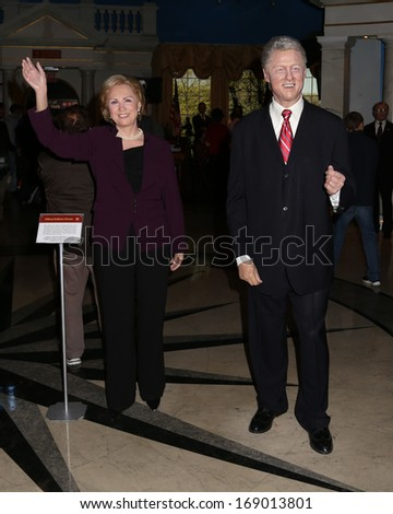 NEW YORK - Dec 6: Wax figures of Bill Clinton and Hillary Clinton are seen on display at Madame Tussauds on December 6, 2013 in New York City. - stock photo