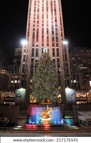 NEW YORK - DECEMBER 7: A Christmas tree towers over the Ice Rink at Rockefeller Center on December 7, 2009 in New York, NY, USA. - stock photo