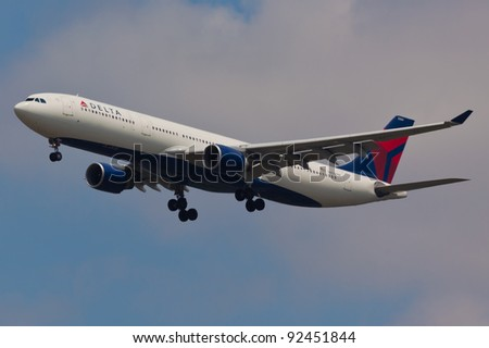 NEW YORK - DECEMBER 21: Airbus A330 approaches JFK Airport located in New York, USA on December 21, 2011 Delta Air Lines is one of the major American Airlines is rated top 10 the biggest in the world