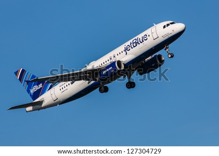 NEW YORK - DECEMBER 6: Airbus A320 JetBlue approaching JFK in New York USA on December 6, 2012 A320 is biggest competition to the most popular mid-range plane 737NG It is wearing livery called Barcode - stock photo