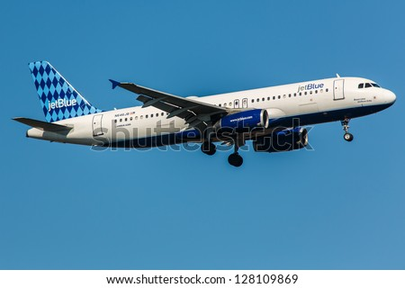 NEW YORK - DECEMBER 8: Airbus A320 JetBlue climbs after take off from JFK in New York USA on December 8, 2012 The A320 the first narrow body airliner is the biggest competition to Boeing 737NG - stock photo