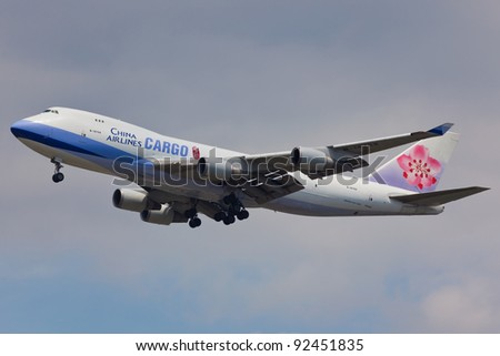 NEW YORK - DECEMBER 21: Boeing 747 China Airline on short final to JFK airport in New York, USA on December 21, 2011 is the flag and biggest carrier of the Republic of China commonly known as Taiwan - stock photo