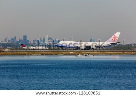 NEW YORK - DECEMBER 6: Boeing 747 China Airlines lining up on JFK runway in New York USA on December 6, 2012. China Airlines is Taiwan's largest airline company and one of Asia's leading carriers
