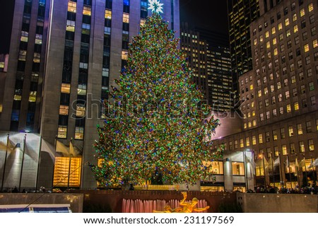 New York - DECEMBER 20, 2013: Christmas Tree at Rockefeller center on December 20 in USA, New York. Christmas Tree at Rockefeller center is the most famous christmas tree in USA - stock photo