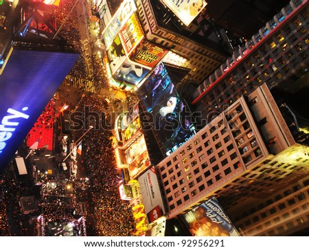 NEW YORK - DECEMBER 31: Crowds gather to celebrate New Years Eve in New York  City's Time Square on December 31, 2011. it is one of the largest street celebrations of this kind. - stock photo