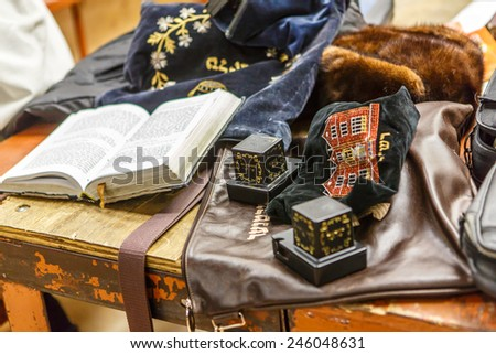 NEW YORK - DECEMBER 26: Jewish ritual items called Tefillin and prayer book in the famous 770 Chabad Lubavitch headquarter and home to last Chabad leader Menachem Mendel Schneerson on December 26 2014 - stock photo