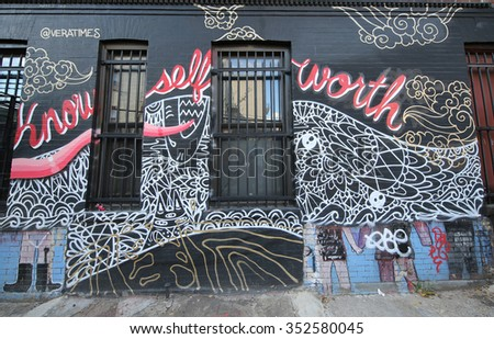 NEW YORK - DECEMBER 15, 2015: Mural art at Dodworth Street in Brooklyn. A mural is any piece of artwork painted or applied directly on a wall, ceiling or other large permanent surface