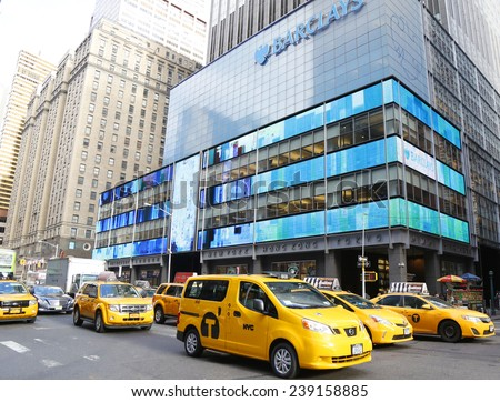 NEW YORK - DECEMBER 18 New York City Taxis on December 18, 2014. New York City has around 6,000 hybrid taxis, representing almost 45 percent of the taxis in service, the most in any city in America  - stock photo