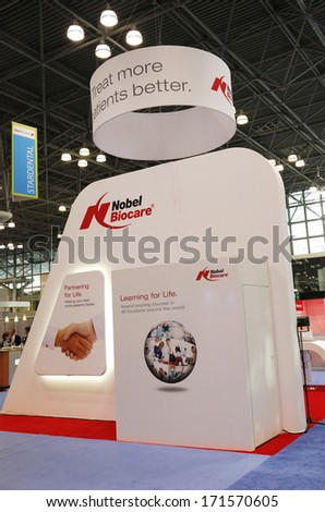 NEW YORK - DECEMBER 2: Nobel Biocare booth at the Greater NY Dental Meeting in New York on December 2, 2013. Nobel Biocare is a company that manufactures dental implants and CAD/CAM-based prosthetic - stock photo