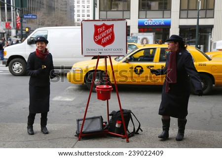 NEW YORK - DECEMBER 18: Salvation Army soldiers perform for collections on December 18, 2014 in midtown Manhattan. This Christian organization is known for its charity work, operating in 126 countries - stock photo