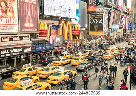 NEW YORK - DECEMBER 22, 2014: taxicabs and traffic jam congestion in front of Mc Donalds in Times Square in Manhattan, New York. Times Square is one of the world's most visited tourist attractions.  - stock photo