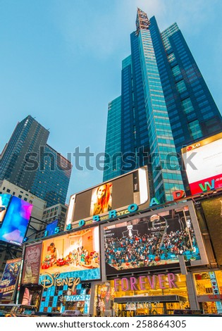 New York - DECEMBER 22, 2013: Times Square on December 22 in USA, New York. Times Square is the most popular tourist spot in New York - stock photo