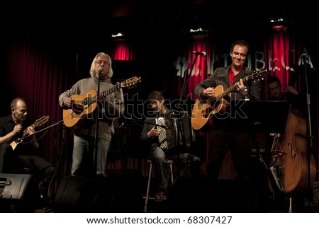 NEW YORK - DECEMBER 17: Tribute to George Brassens with Pierre De Gaillande Bad Reputation and Joel Favreau guitar & Jean Jacques Franchin accordion at 92Y Tribeca on December 17, 2010 in New York - stock photo