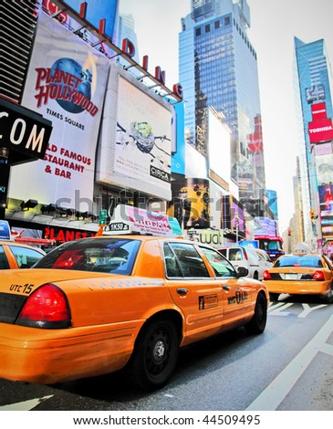 NEW YORK - DECEMBER 29: Yellow cabs speed through Times Square landmark during run up preparations for New Years Eve event on Dec 29, 2009 in New York, NY, USA. - stock photo