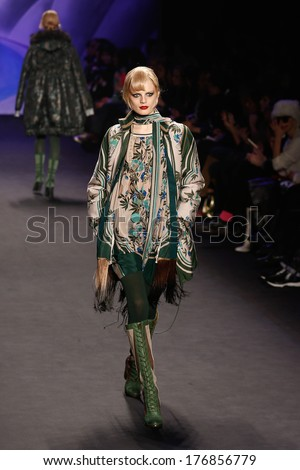 NEW YORK-FEB 12: A model walks the runway at the Anna Sui fashion show during Mercedes-Benz Fashion Week Fall 2014 at the Theatre at Lincoln Center on February 12, 2014 in New York City.