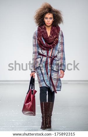 NEW YORK-FEB 9: A model walks the runway at the Tracy Reese fashion show during Mercedes-Benz Fashion Week Fall 2014 at Center 548 on February 9, 2014 in New York City. - stock photo