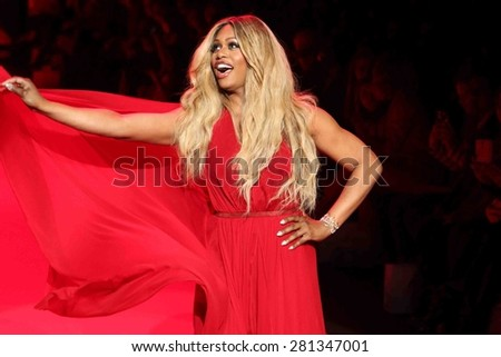 NEW YORK-FEB 12: Actress Laverne Cox wears Donna Karan at Go Red for Women-The Heart Truth Red Dress Collection at Mercedes-Benz Fashion Week at Lincoln Center on February 12, 2014 in New York City. - stock photo