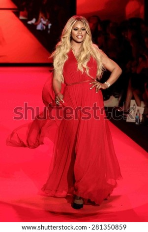 NEW YORK-FEB 12: Actress Laverne Cox wears Donna Karan at Go Red for Women-The Heart Truth Red Dress Collection at Mercedes-Benz Fashion Week at Lincoln Center on February 12, 2015 in New York City. - stock photo