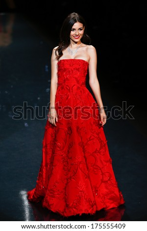 NEW YORK-FEB 6: Actress Victoria Justice wears Oscar de la Renta at The Heart Truth Red Dress Collection show during Mercedes-Benz Fashion Week at Lincoln Center on February 6, 2014 in New York City. - stock photo