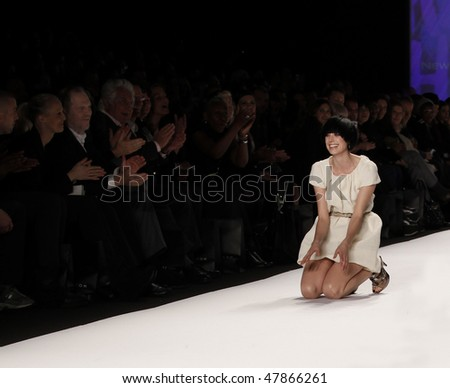 NEW YORK - FEB 12: Agyness Deyn stumbles on runway as Harvey Weinstien watches at Naomi Campbell's Fashion For Relief Haiti 2010 Fashion Show during Mercedes-Benz Fashion Week on Feb 12, 2010 in NYC