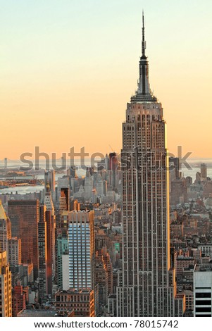 NEW YORK - FEB 21 : Empire state building facade at sunset pictured on February 21, 2010 in NYC. It stood as the world's tallest building for more than 40 years (from 1931 to 1972). - stock photo