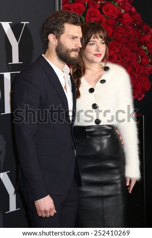 "NEW YORK - FEB 5, 2015: Jamie Dornan and Dakota Johnson attend a screening of ""Fifty Shades of Grey"" at the Ziegfeld Theatre on February 5, 2015 in New York."