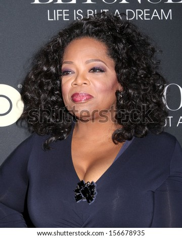 "NEW YORK - FEB 12:  Oprah Winfrey attends the premiere of ""Beyonce: Life Is But A Dream"" at the Ziegfeld Theatre on February 12, 2013 in New York City. - stock photo"