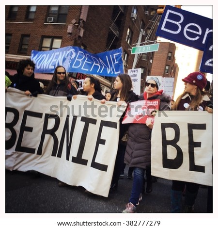 NEW YORK - 27FEB16: Supporters of US Presidential candidate Bernie Sanders carry signs and chant as they march down Broadway on February 27, 2016 in NYC - stock photo