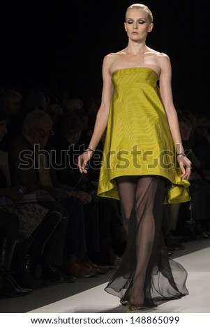 NEW YORK - FEBRUARY 10: A model is walking the runaway at Ralph Rucci Show for Fall/Winter 2013 Collection during Mercedes-Benz Fashion Week on February 10, 2013 in New York