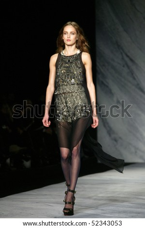 NEW YORK - FEBRUARY 17: A model is walking the runway at the PHILLIP LIM Collection for Fall/Winter 2010 during Mercedes-Benz Fashion Week on February 17, 2010 in New York. - stock photo