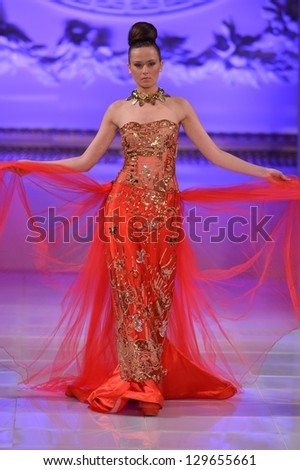 NEW YORK - FEBRUARY 17: A model walks runway for Lourdes Atencio collection at New Yorkek Hotel during Couture Fashion Week on February 17, 2013 in New York City - stock photo