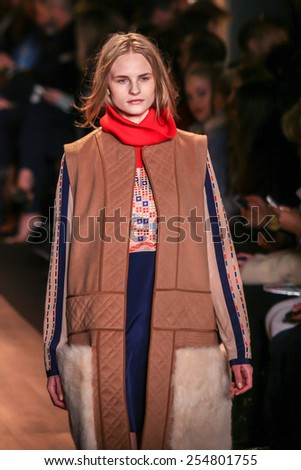 NEW YORK - FEBRUARY 12: A model walks the runway at the BCBGMAXAZRIA Fall/Winter 2015 collection during Mercedes-Benz Fashion Week in New York on February 12, 2015.