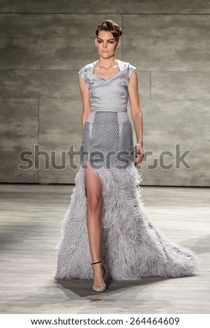 NEW YORK - FEBRUARY 18: A model walks the runway at the Bibhu Mohapatra Fall/Winter 2015 collection during Mercedes-Benz Fashion Week in New York on February 18, 2015. - stock photo