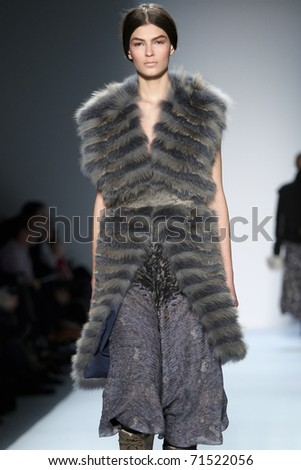 NEW YORK - FEBRUARY 16: A model walks the runway at the Christian Cota Fall 2011 Collection presentation during Mercedes-Benz Fashion Week on February 16, 2011 in New York.