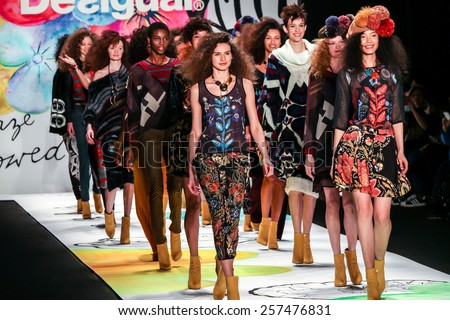 NEW YORK - FEBRUARY 12: A model walks the runway at the Desigual Fall/Winter 2015 collection during Mercedes-Benz Fashion Week in New York on February 12, 2015. - stock photo